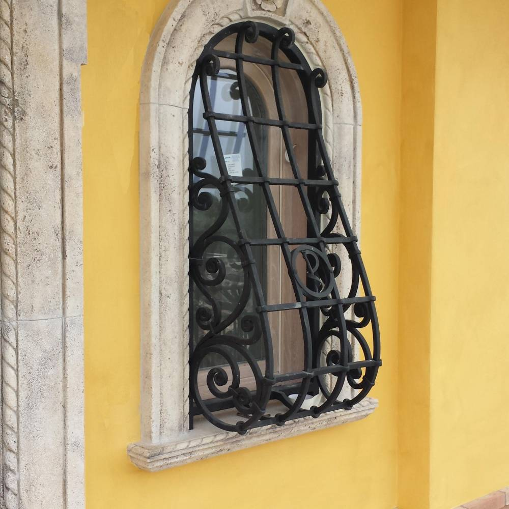 Protection grille for window in wrought iron