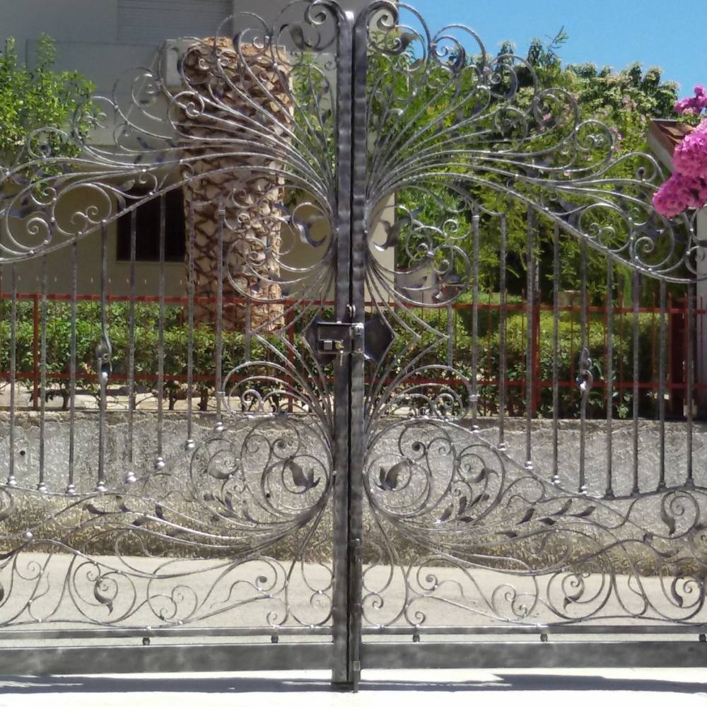 Decorated gates in wrought iron made in italy