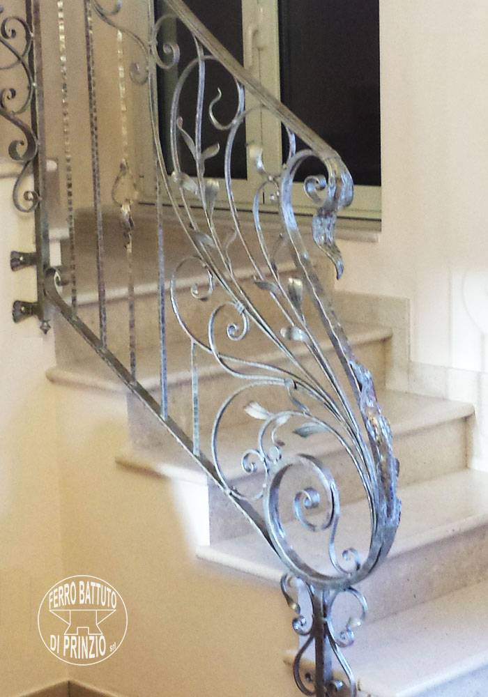 Railing for interior stairway in hand-crafted wrought iron,