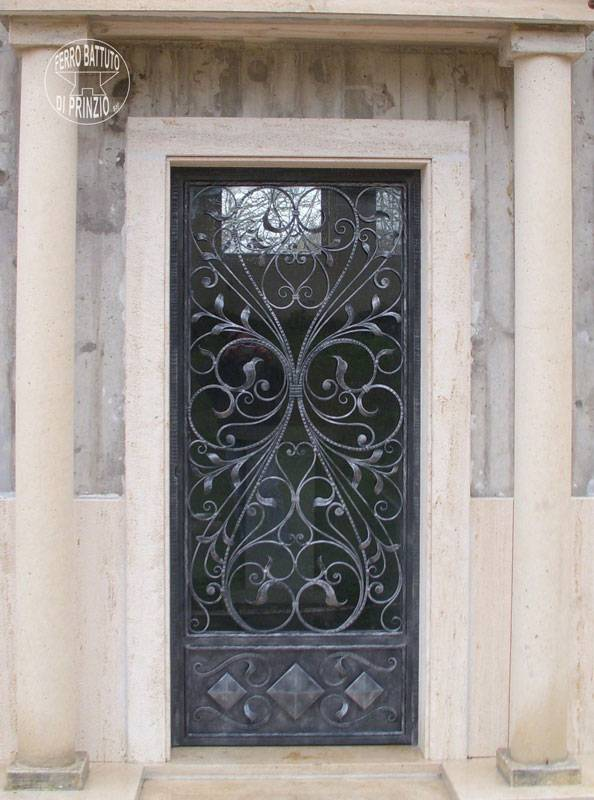 Wrought iron door with decorations of leaves