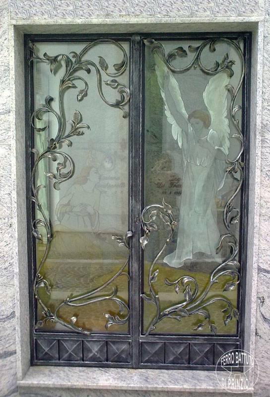 Wrought iron door with gold decoration