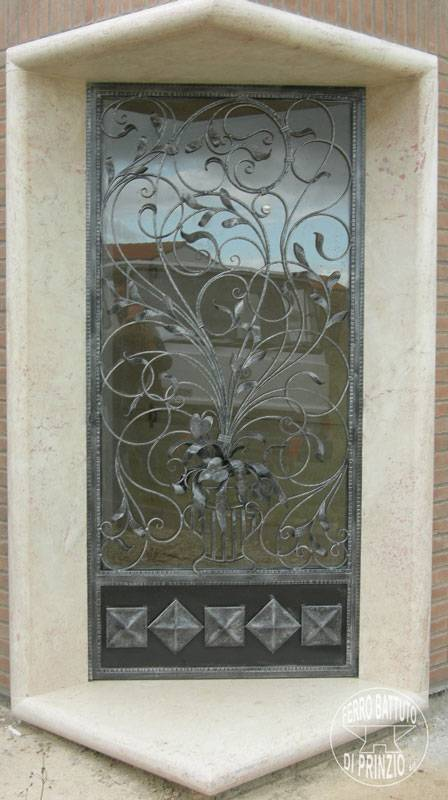 Wrought iron door richly decorated