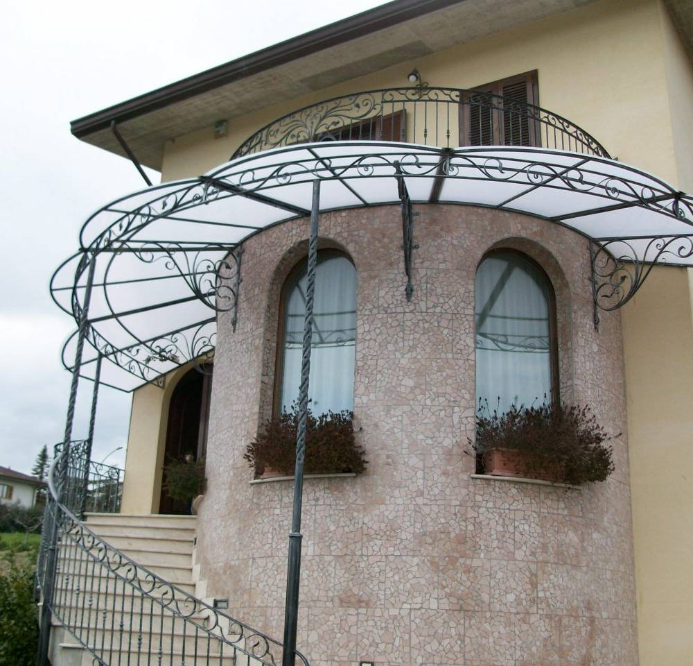 circular and artistic wrought iron canopy