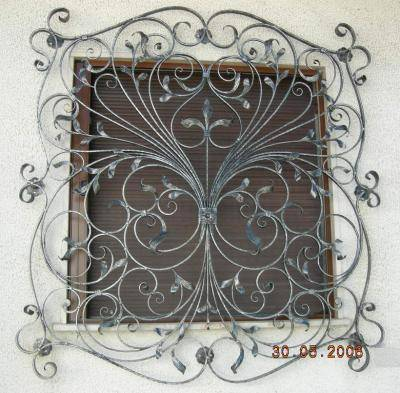 decorated wrought iron grate