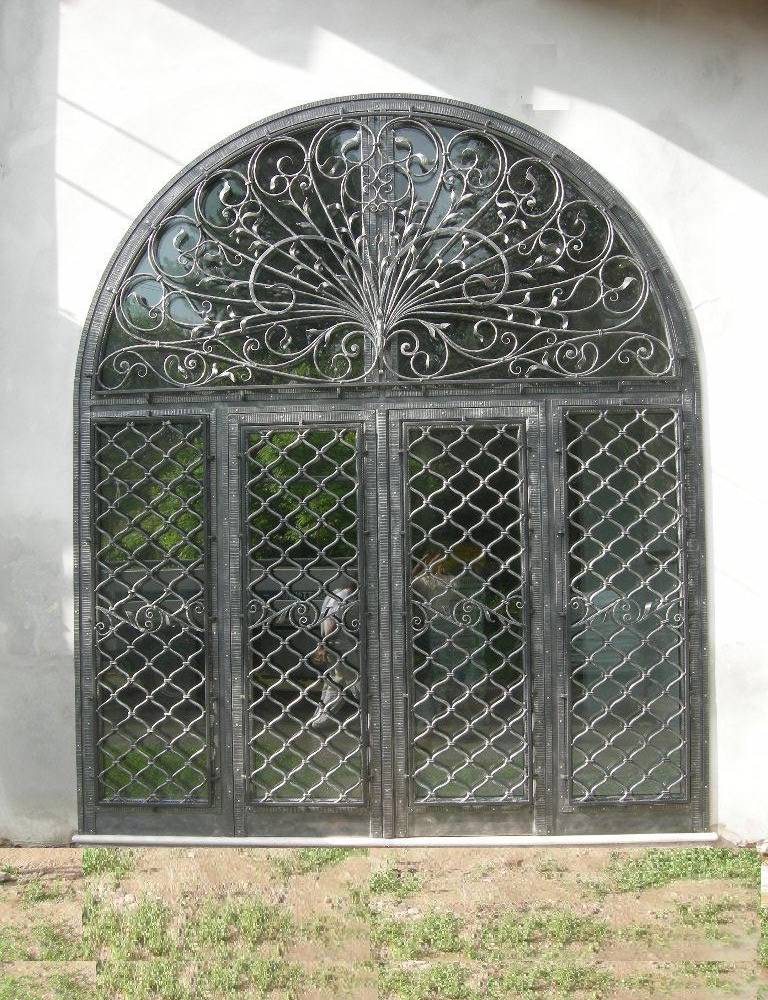 hammered and large wrought iron entrance door