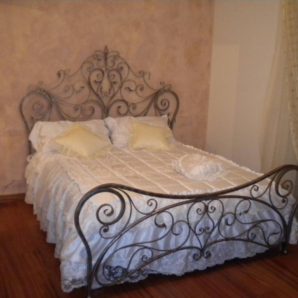 Wrought iron bed with floral decoration