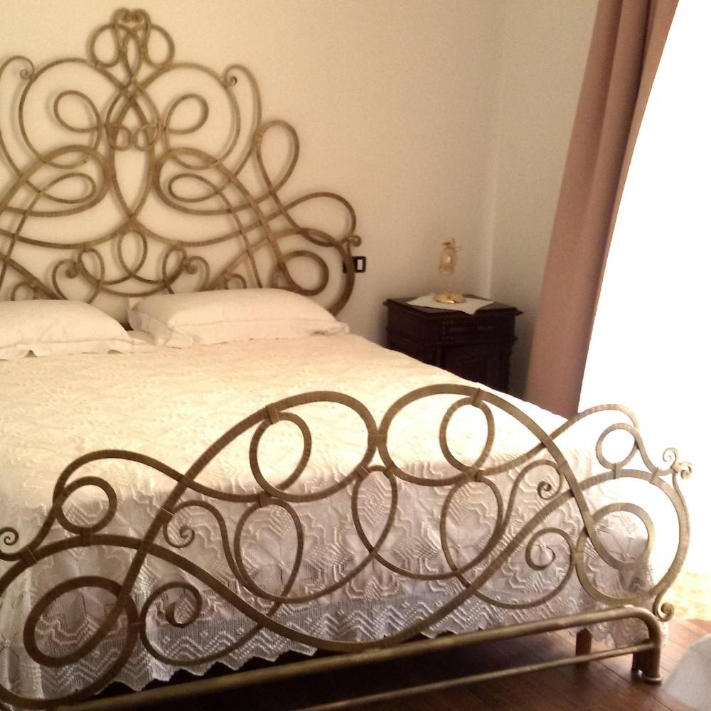 Wrought iron bed with modern design