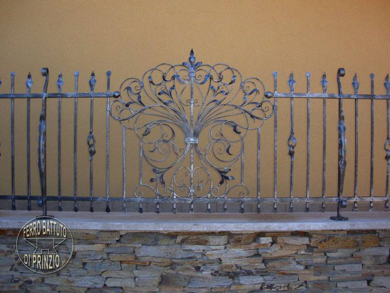 Wrought iron fence with volute