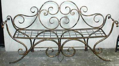 Wrought iron bench with floral decoration