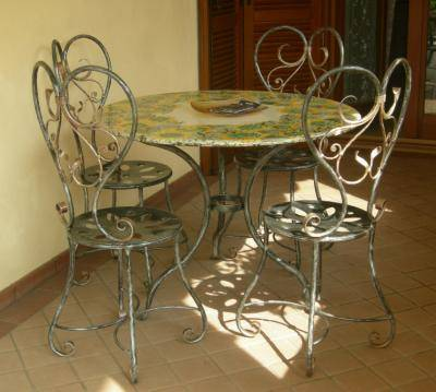 Wrought iron chairs with table