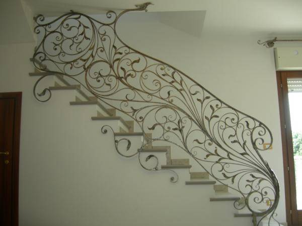 Wrought iron railing for interior stairway