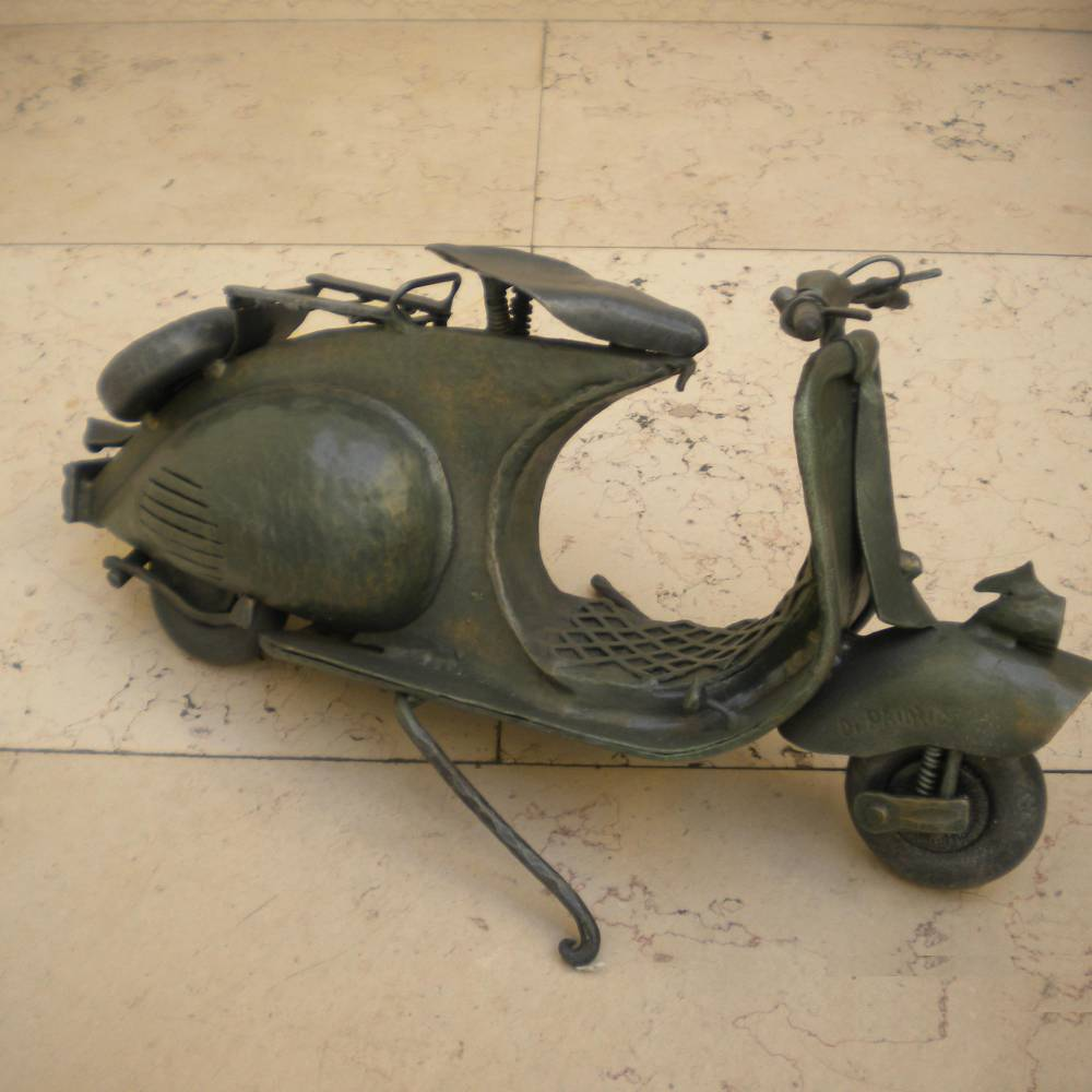 wrought iron sculpture representing a vespa