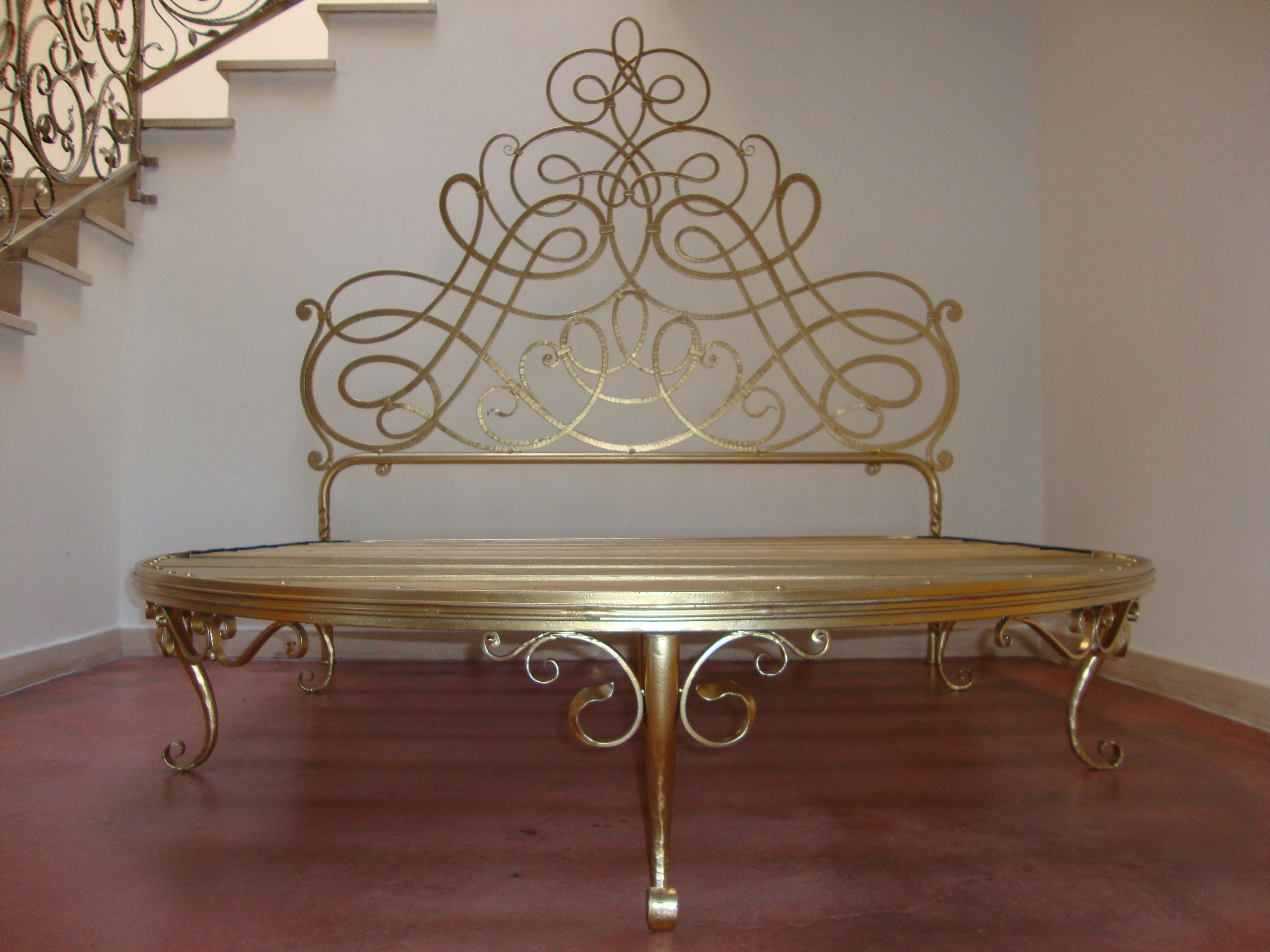 bed in gilded wrought iron with round foot